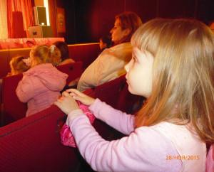 В театре.